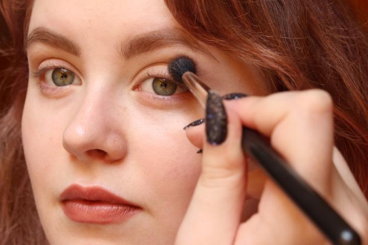 Applying eyeshadow